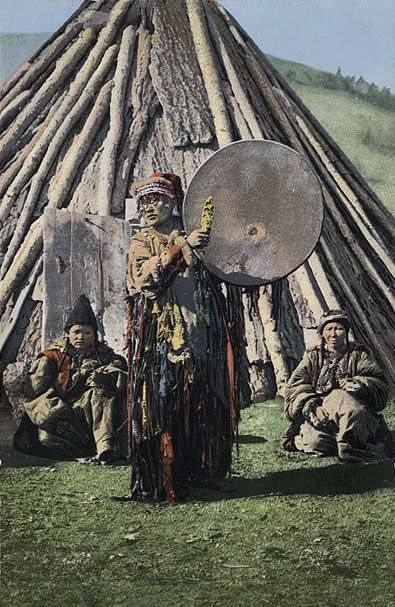 Female shaman with drum from Altai region of Siberia. The drum, often assisted by psychoactive fly agaric mushrooms, summoned the shaman's spiritual helpers, sheltered the souls of a sick person, and defended the shaman against malevolent spirits.