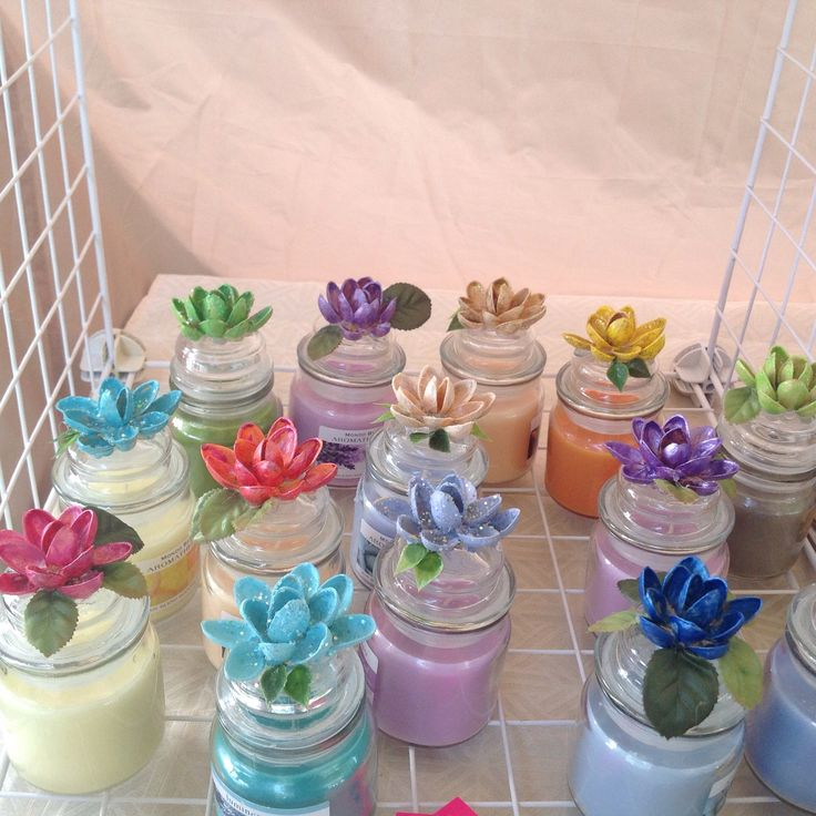 Pistachio shell flowers on candle jars.