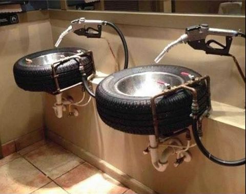 tires + stainless bowls + gas pump handles = the most unique bathroom sinks ever.