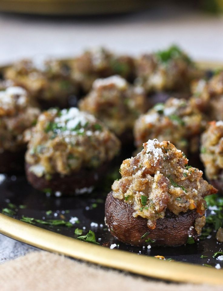 Sausage/Meats Stuffed Mushrooms Recipe. Need ideas and recipes for easy small bites or appetizers for Thanksgiving, new years eve or Christmas parties? Entertaining for the holidays is easy with crowd pleasers like this for your party! Families will love these.