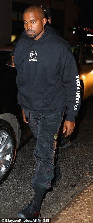 Low-tops: He of course also wore a pair of his black Adidas Yeezy Boost sneakers with matching black Adidas socks