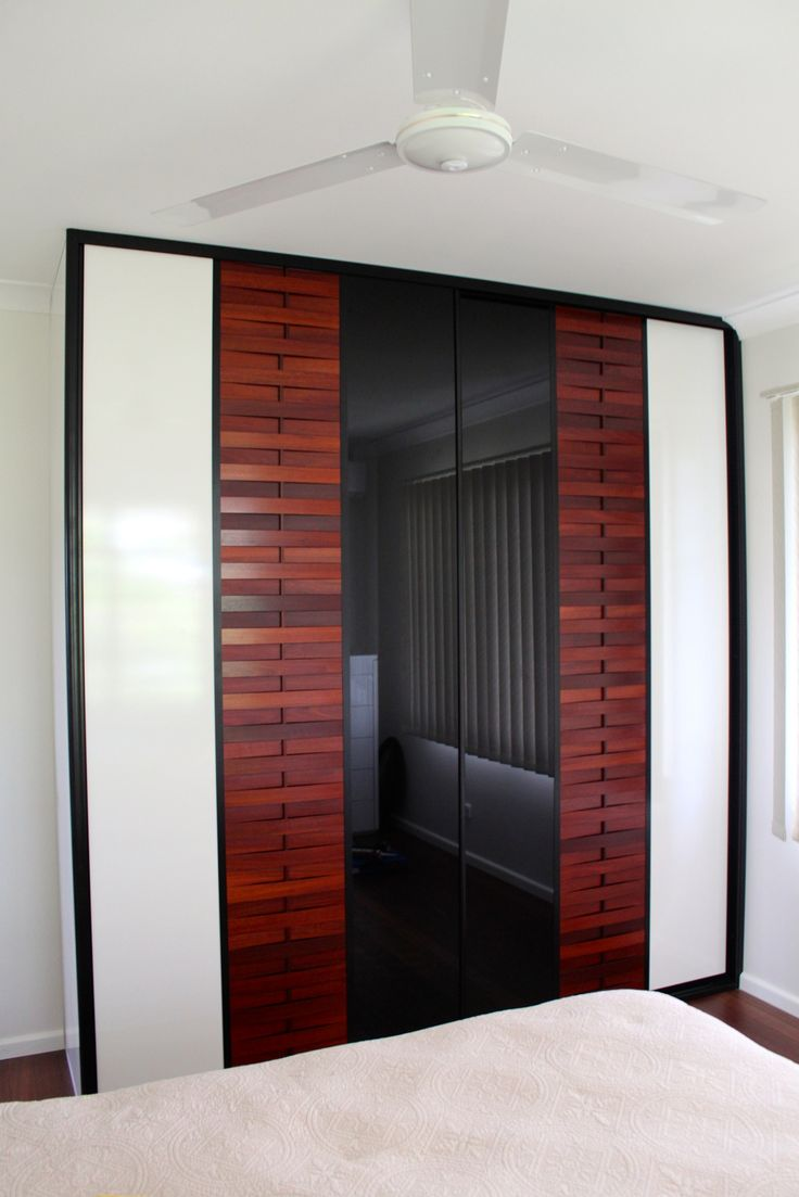 These beautiful Sliding Doors are from our Sukiya range.  We have combined black glass, super white gloss laminate with timber that was stained to match the beautiful timber floor. What do you think?  Pic 2/2.  www.formfunctionnt.com.au