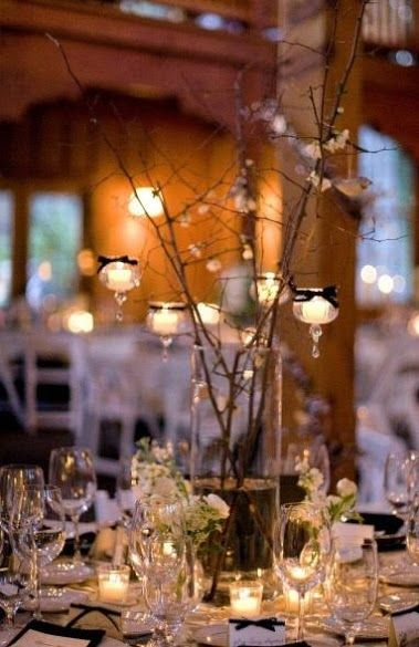 hanging candles in twigs, rustic wedding idea