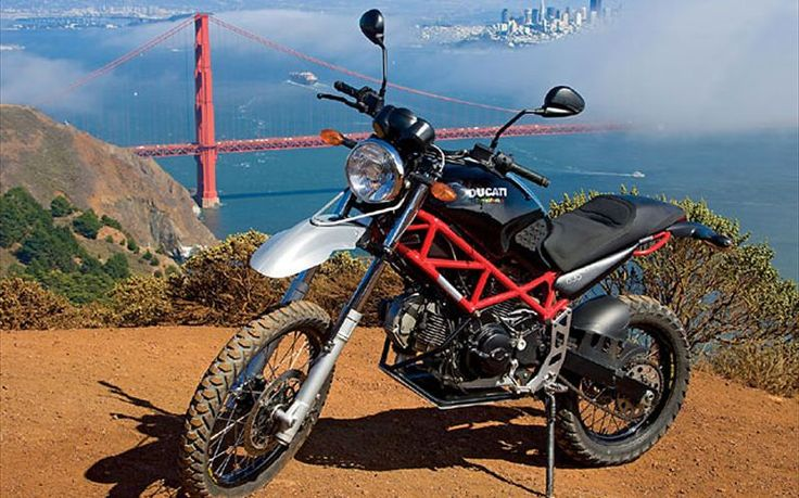 A Ducati 695 Monster gets converted into a dirt ready Dual Sport by Overland Motorcycles of California . Oh how that booming Ducati V-Twin exhaust note must sound on the trail.  That red trellis frame is gorgeous as well.
