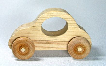 This is an adorable wooden toy car for children. It is made of pine and the wheels are maple. The car moves smoothly across the floor and