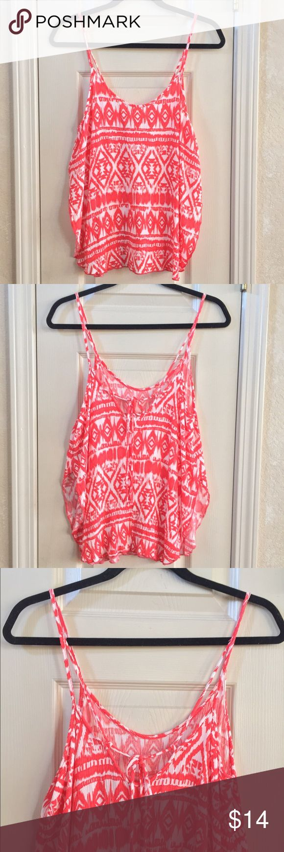 Pink Tribal Print Tank Tribal print tank top with slits on the sides. 100% polyester. Persaya Tops Tank Tops