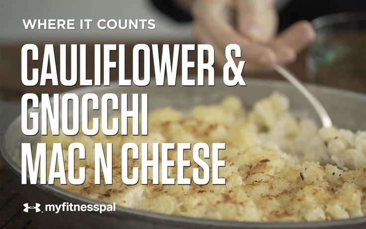 """This cauliflower """"mac"""" n cheese by Love and Zest is made with tiny pillows of chewy gnocchi, a potato-based dumpling, instead of macaroni. Baked to perfection in its cheesy goodness, have a bowl of """"mac"""" n cheese, and eat your veggies, too!"""