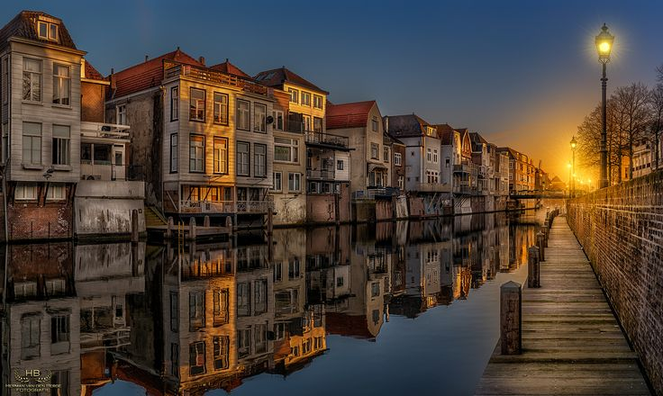 Reflections of Gorinchem - Last week I visited the city of Gorinchem on a cold morning with beautiful calm water to get some excellent reflections of the beautiful old houses in one of the canals there. Gorinchem is a city in the western Netherlands, in the province of South Holland................