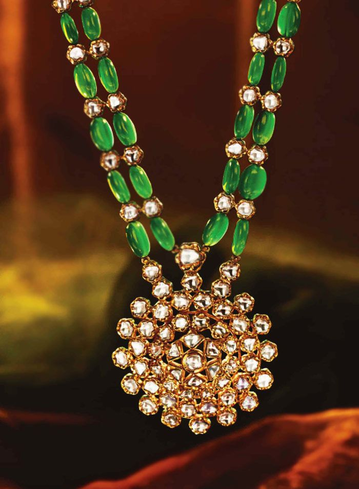 Tanishq Rani haar is a modern depiction of ancient regal polki work and Emerald beaded string that delightfully embellishes the princess of the ceremony.