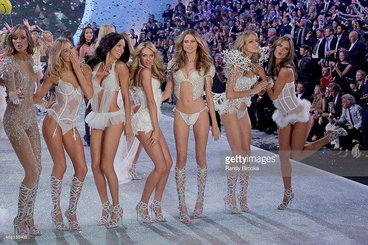 Models Karlie Kloss, Douzen Kroes, Adriana Lima, Candice Swanepoel, Behati Prinsloo, Lindsay Ellingson and Alessandra Ambrosio walk in the 2013 Victoria's Secret Fashion Show at Lexington Avenue Armory on November 13, 2013 in New York City.