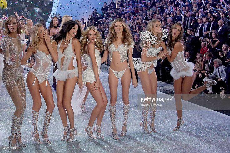 Models Karlie Kloss, Douzen Kroes, Adriana Lima, Candice Swanepoel, Behati Prinsloo, Lindsay Ellingson and Alessandra Ambrosio walk in the 2013 Victoria's Secret Fashion Show at Lexington Avenue Armory on November 13, 2013 in New York City.