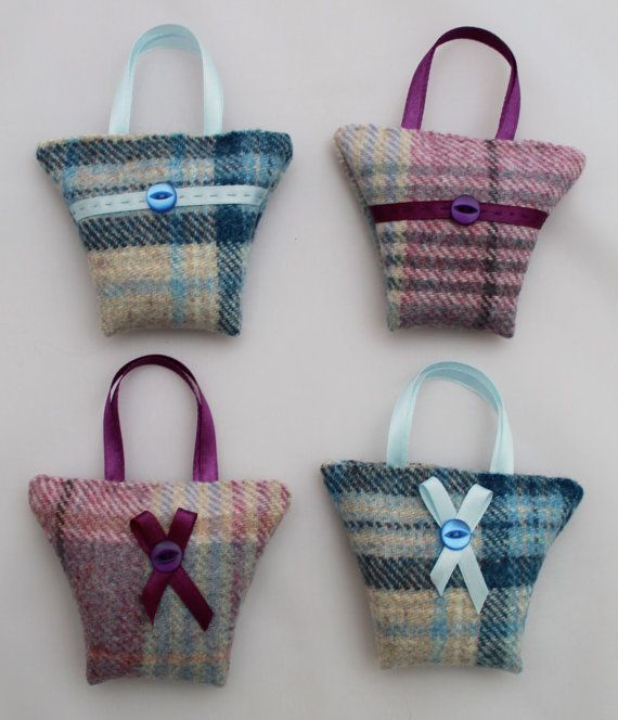 Cute little tweed handbag shapes filled with aromatic French dried lavender. These bags measure approximately 10cm x 8cm (4 x 3) not including the ribbon handle. They are machine sewn at the side seams and hand sewn closed once filled. Choose a ribbon stripe and button detail or a ribbon bow and button. A lovely little gift and would make a great Christmas stocking filler.  Choose from 4 gorgeous colours of lovely soft tweed, green, blue, lilac and pink. Lavender scent will last for many…