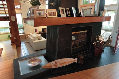 Amazing two-sided fireplace in Raven Spanier's Moncton, New Brunswick home from the fall 2011 issue