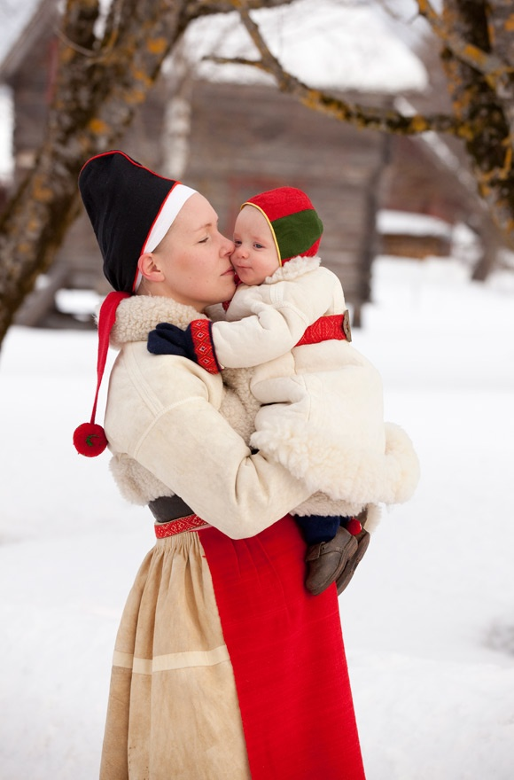 """""""These are the clothes used in Boda during winter. The baby is kept warm in a fur coat, a""""kolt"""", with knitted stockings and mittens. His tiny, tiny shoes are the same model as adult shoes."""" Text and photo by Laila Duran of Folklore Fashion"""
