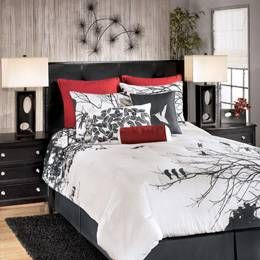 I love the branches and parts and the black and white scheme with a touch of red. The Home Decorating Company