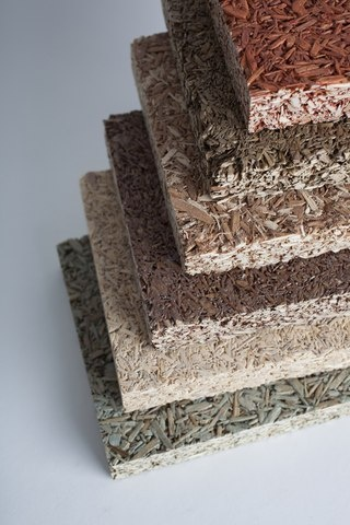 Recycled fiber acoustical panels for ceiling and wall surfaces.