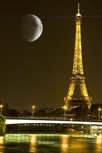 Paris By Moonlight - the Eiffel Tower lit with reflection in water.
