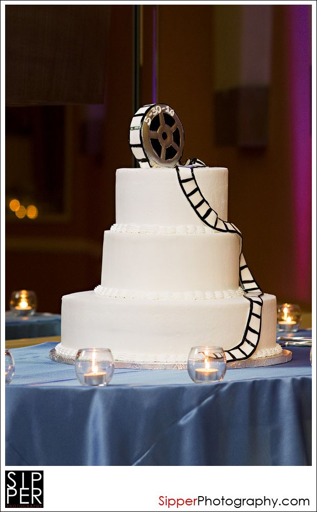 Movie Theme Wedding Cake - a bit too simplistic but a good core concept if we did a movie themed wedding.