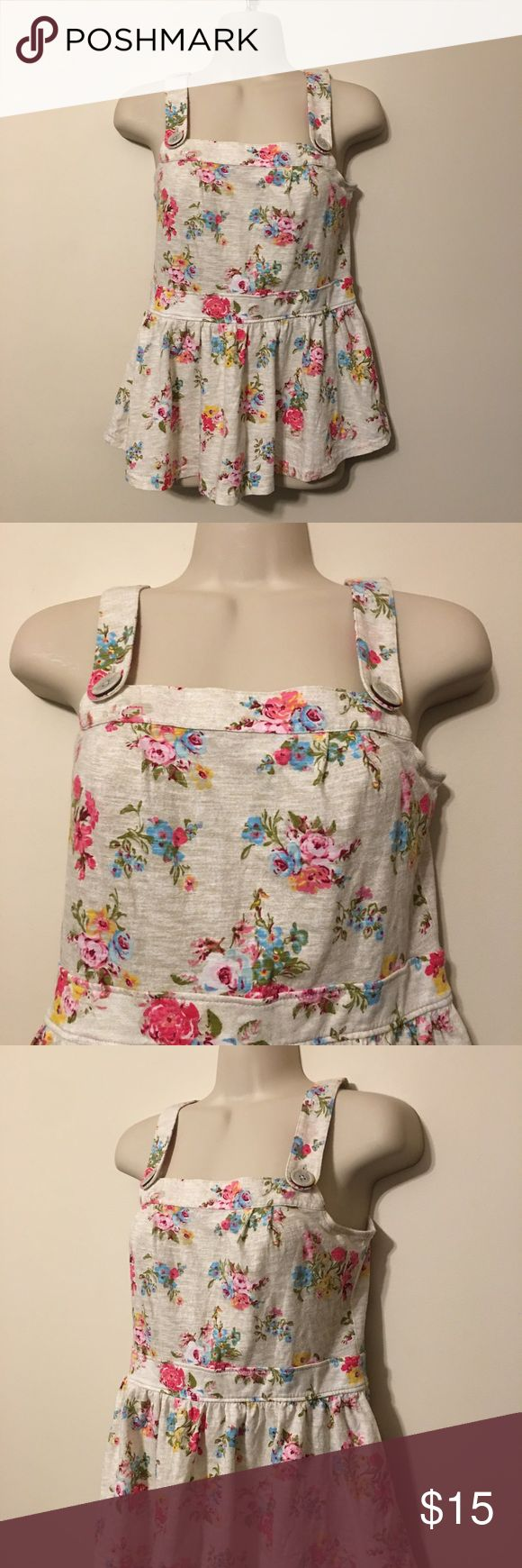 Next Junior's Floral Jumper Tank Next Junior's Floral Jumper Tank. Tag says the size is 13 years. Please ask for measurements before purchasing. Next Tops Tank Tops