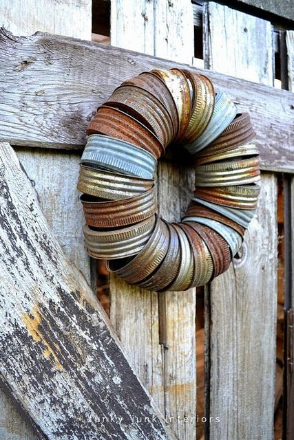 a wreath made from rusty jar lids ... funky junk at its best!!