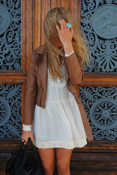 Sweet look. I love the contradiction of the delicate dress and the leather jacket.