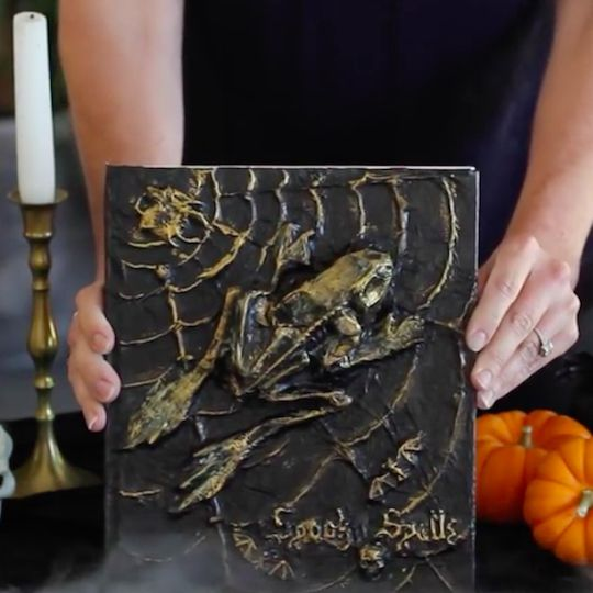 Repurpose old books into bewitching spell books. Your bookshelves will look extra spooky for Halloween!
