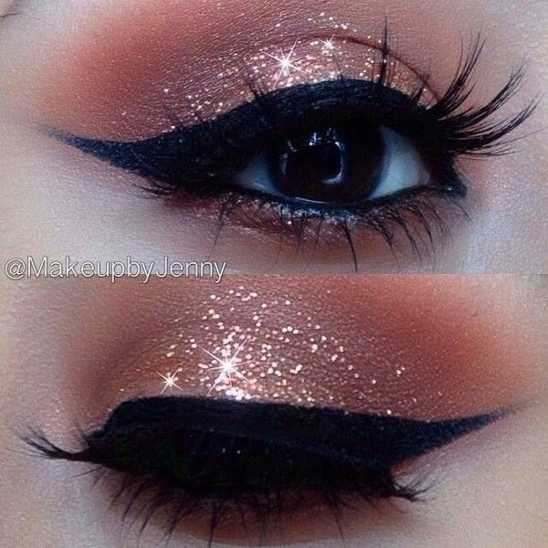 Retro cat eye look with pink glitter shadow.
