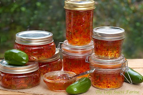 """The Café Sucré Farine: Red & Green Pepper Jelly """"After taking photos of the gorgeous concoction, I set out a plate of crackers and a small portion of cream cheese with the pepper jelly spooned over the top. """"WOW""""! That's what we both said when we took the first bite  and repeated the same """"WOW"""" with each succeeding bite. It's sweet, savory, spicy, incredibly delicious and amazingly addictive (we polished off that small bowl you see in the picture lickety-split). You just HAVE to try it!"""""""