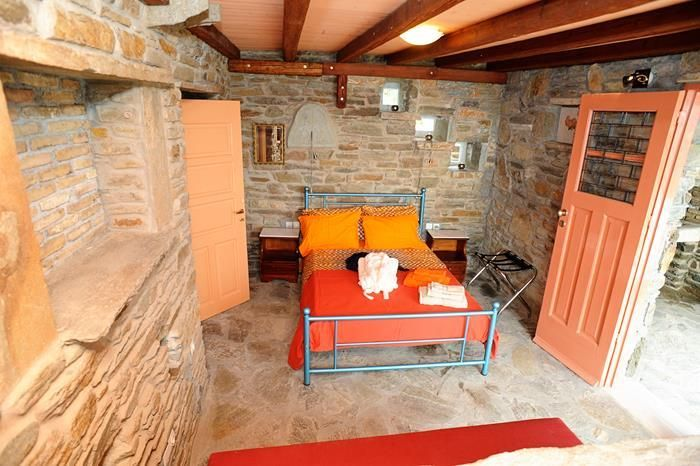 The stone double bedroom in the Orange House in Tinos Habitart http://www.tinos-habitart.gr/orange-house.php
