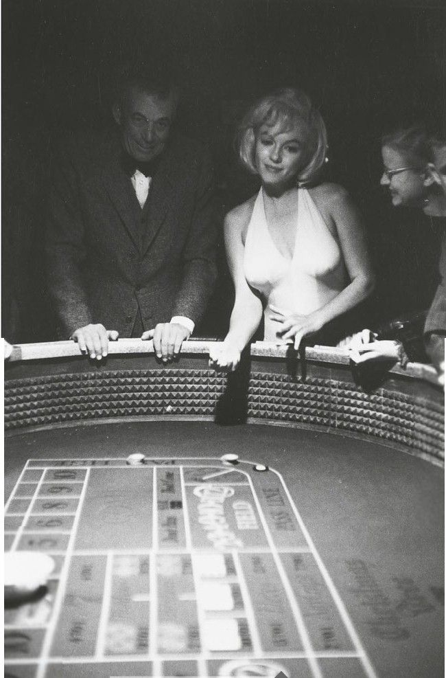 "Director John Huston & Marilyn Monroe at a Reno casino during the filming of ""The Misfits"" 1960. Photo by Eve Arnold."