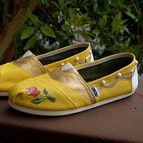 Get these custom painted princess TOMS. | 33 Subtle Ways To Add Your Love Of Disney To Your Wedding