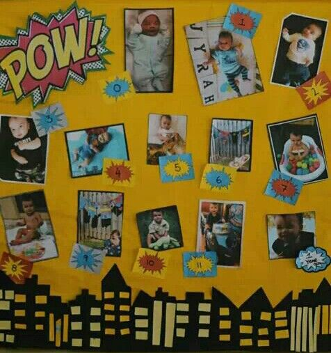 My son's first twelve months. ..photo canvas display at his superhero party