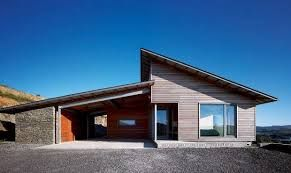 3.Mono-pitched roof goes over the garage and living area going opposite directions.
