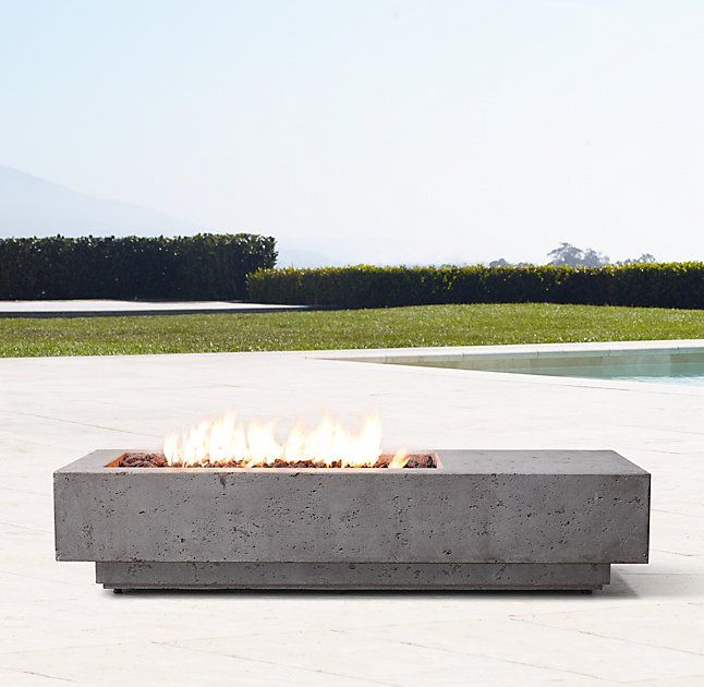 Ixtapa Asymmetrical Rectangular Fire Table PROPANE: Attaches to a standard 20 lb. propane tank (not included) with included 10' commercial-grade connector hose.  The use of our tank cover (sold separately) is recommended to attractively house the propane tank, which cannot be concealed within the fire table unit.