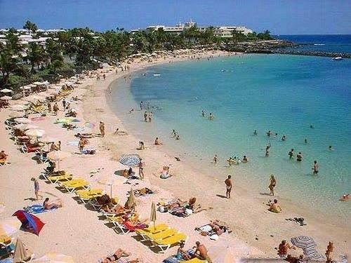 Spanish Holidays On the Canary Islands Lanzarote Playa Blanca The best local beach, Playa Blanca, has 3km of golden sand and lies just 6km away from the airport. Playa Blanca Lanzarote holiday Beach
