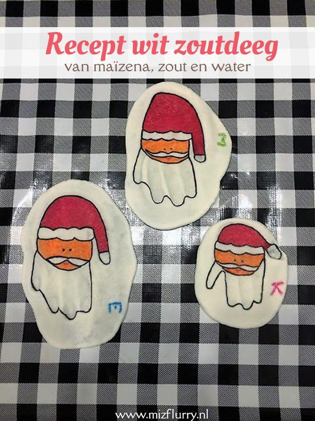 We maakten handafdrukken in wit zoutdeeg gemaakt van maïzena, zout en water. Met stiften maakte ik er grappige kerstmannen van. Aangepast recept.
