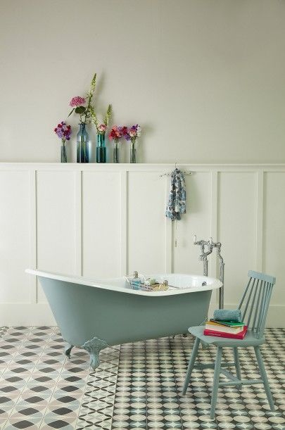 Slipper bath painted in Farrow  Ball's 'oval room blue' set against 'Pointing' wood panelling and 'Slipper Satin' walls.  Patterned tiles by Ann Louise Roswald for The Cast Iron Bath Company.