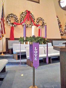 decoration for a Christmas/winter wedding church ceremony... really like the three wreaths with the ribbon gracefully intertwining them