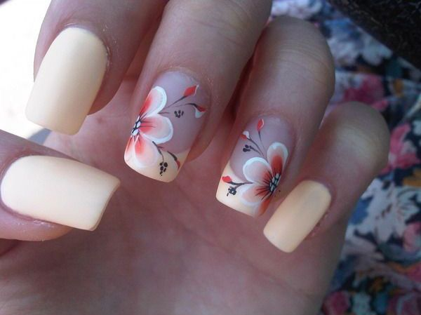 Play around with a creamy matte color on your nails. The design is then topped with a cream and firebrick hues forming a beautiful hibiscus flower. Perfect for venturing the near beaches, this nail art is a great partner for your frilly summer dress and hat.
