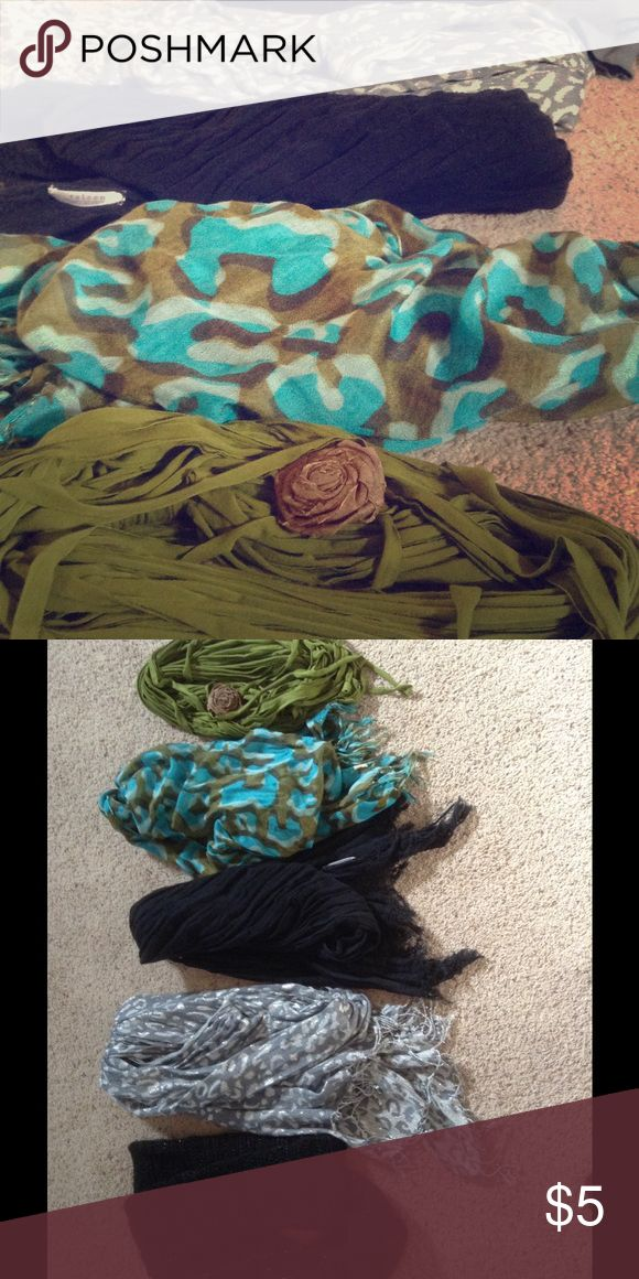 Women's scarves Handful of women's scarves. Black knitted infinity scarf, silver and grey leopard print, blue/black linen, green and blue leopard, and green tshirt scarf with flower pin. $5 each. Willing to adjust price or bundle Accessories Scarves & Wraps