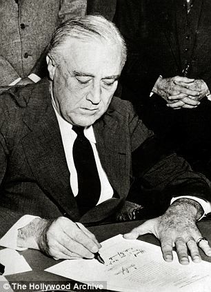 Just 33 minutes after President Roosevelt gave the 'Day of Infamy' speech, Congress passed the declaration of war on Japan (which he is pictured signing here)