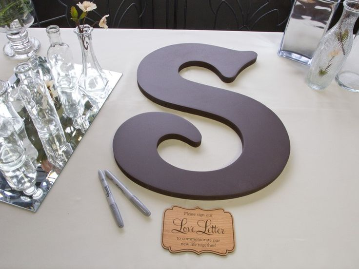 Guests sign this letter instead of a traditional guest book. I love the wording underneath the letter