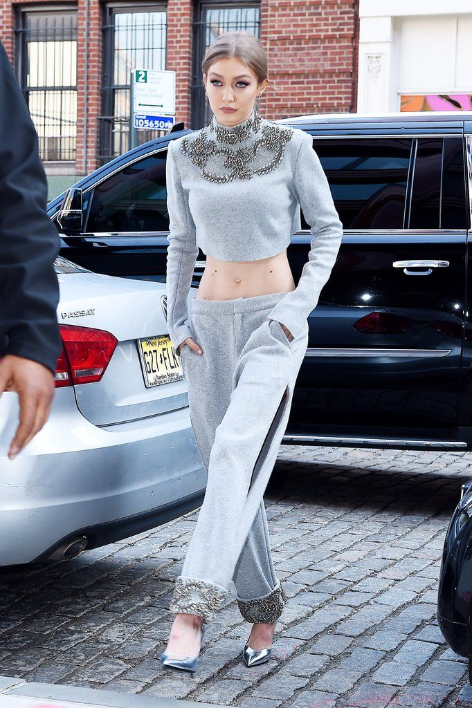 Gigi's all-gray outfit looked warm and cozy. She wore a crystal embellished crop top and sweatpants with si...