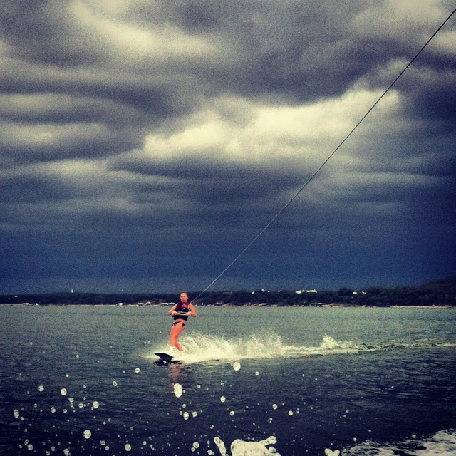 My wakeboarding girl outrunning a storm!