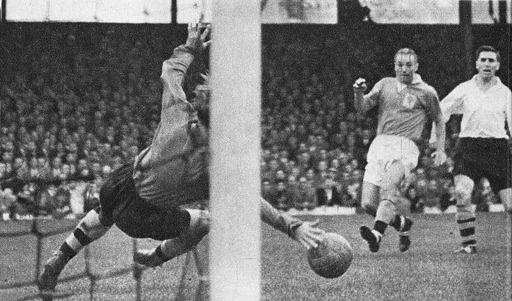 25th August 1956. Blackpool winger Stanley Matthews scoring a rare goal as he beats Wolverhampton Wanderers goalkeeper Bert Williams, at Molinuex.