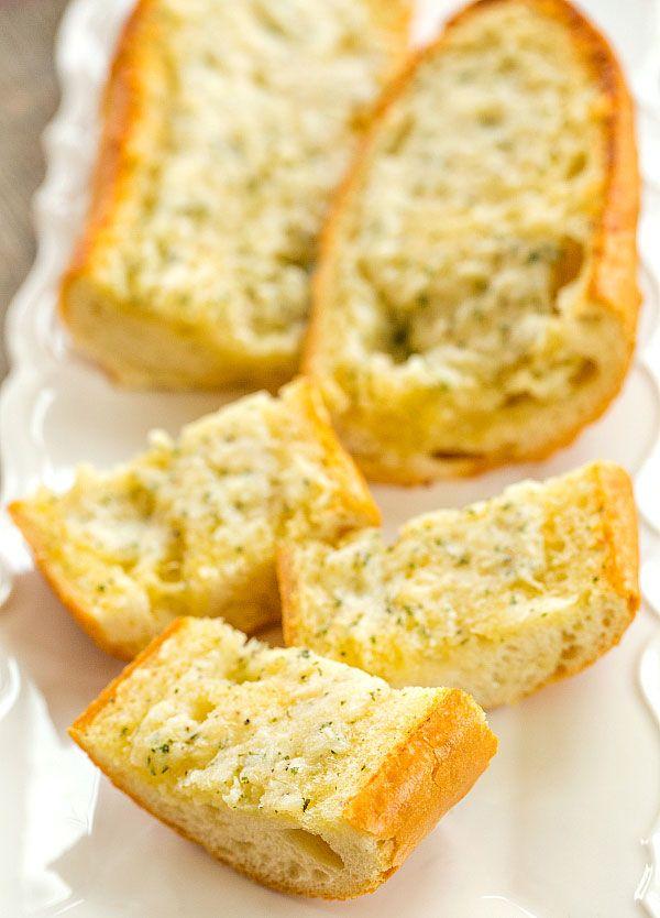 An easy recipe for Cheesy Homemade Garlic Bread - no more frozen loaves of garlic bread!