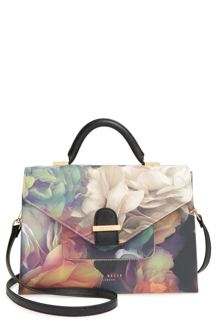 Pillowy blossoms paint this sharply structured tote bag with vintage-inspired, ladylike appeal.