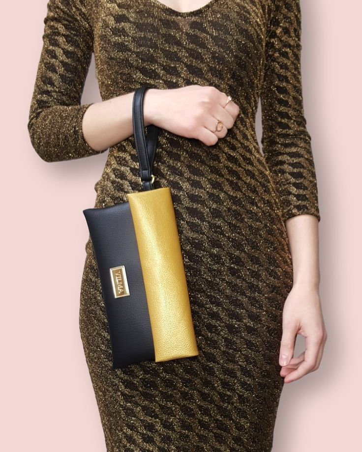 Ethical fashion♻ Look good, do good, feel good. Featuring the vegan gold-black wristlet. Shop at http://vilmaboutique.com
