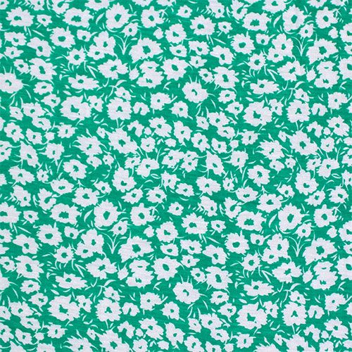 "Emerald Green Daisy Silhouettes Cotton Jersey Blend Knit Fabric - Lovely emerald green color background with white daisy silhouettes on a cotton jersey rayon blend knit.  Fabric is soft with a good stretch, nice drape, and is light weight.  Largest flower measures 1/2"" (see image for scale).  ::  $6.00"