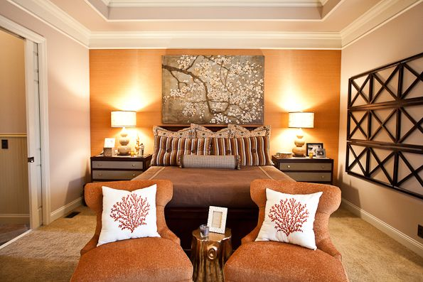 Bedroom with burnt orange accent wall  chairs -- Eric Ross Interiors